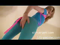 Sexy  golden-haired in constricted spandex dancing and showing petite little titties